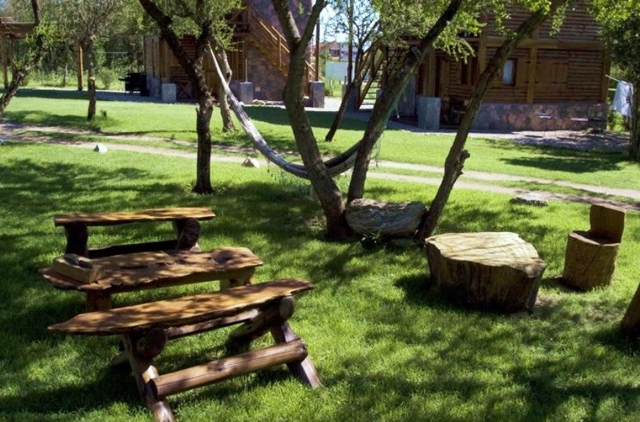 Muebles para exterior en madera mesas sillas sillones for Sillones de madera para exterior