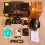 Nikon D5100 + 18-55mm + 55-300mm + 2 Enel14 + Dk21m + 16gb