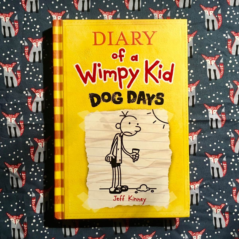 Jeff Kinney.  DIARY OF A WIMPY KID: DOG DAYS.