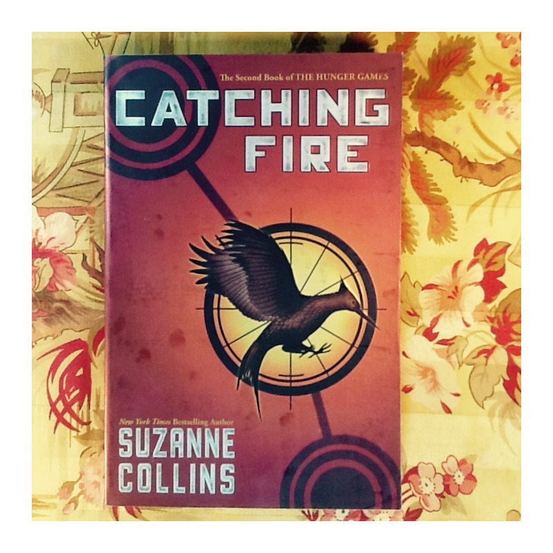 Suzanne Collins.  CATCHING FIRE.